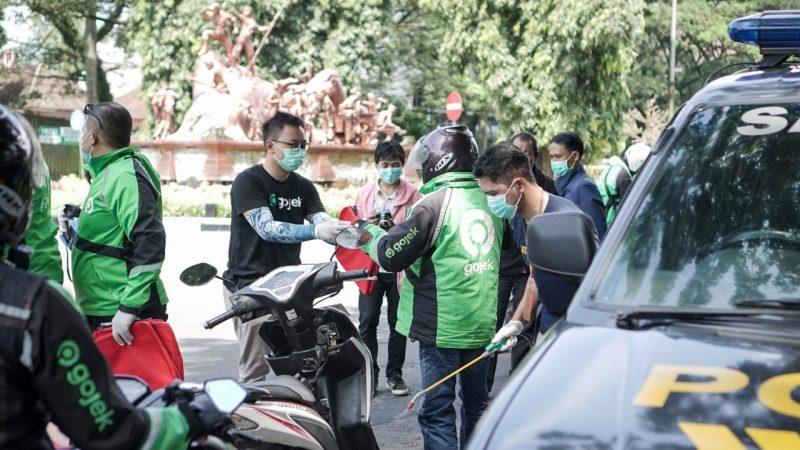Perangi Covid-19, Gojek Malang lengkapi  Ribuan Mitranya dengan Masker dan Hand Sanitizer