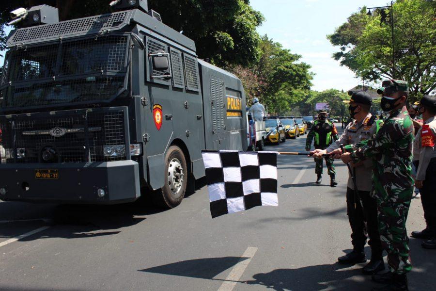 Penyemprotan Disinfektan menggunakan Mobil AWC (Aeromed Water Canon) di Kota Malang